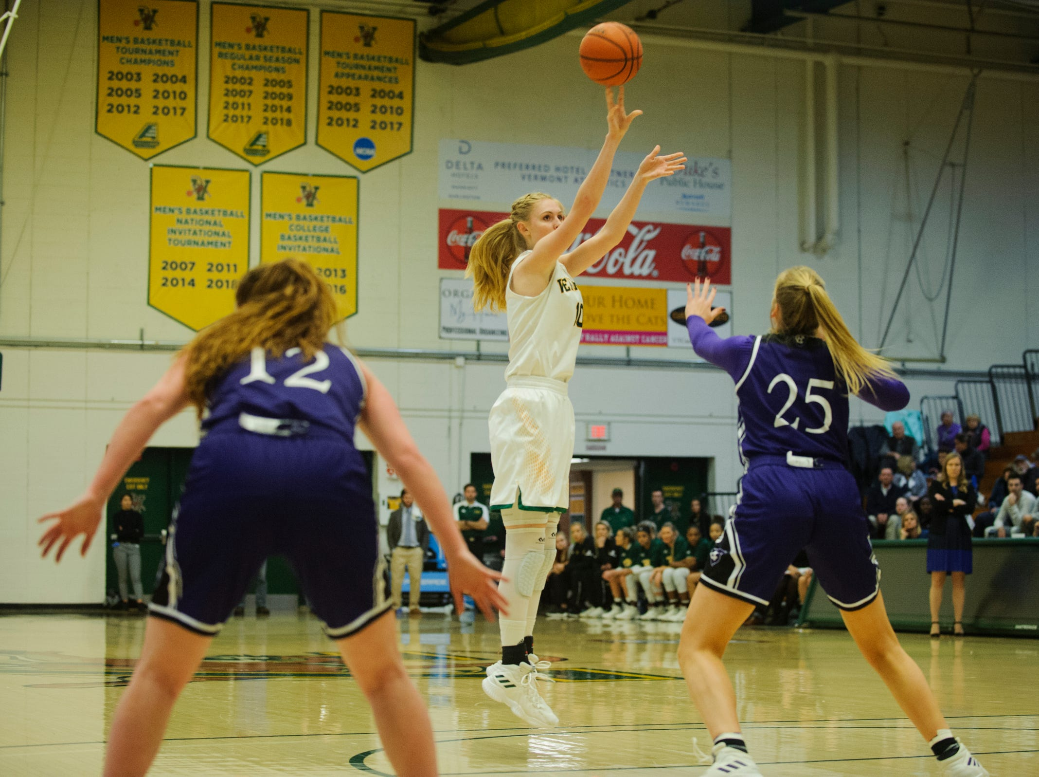 Vermont's Hannah Crymble (10) shoots a three pointer during the women's basketball game between the Holy Cross Crusaders and the Vermont Catamounts at Patrick Gym on Wednesday night November 28, 2018 in Burlington.