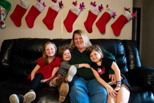 Kayla Look sits with her daughters, from left, Laney, Layla and Libby at their home in Rockport Texas on Wednesday, Nov. 29, 2018.