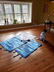 The sleeping bags and bed rolls are made from surgical mats sewn together; they have elastic to bind them once they're rolled up so they're easier to carry.