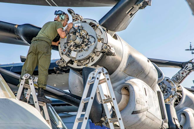 Marine Corps Cpl. Emiliana Flores conducts routine maintenance on a MV-22 Osprey aboard the USS Kearsarge during a training exercise in August.