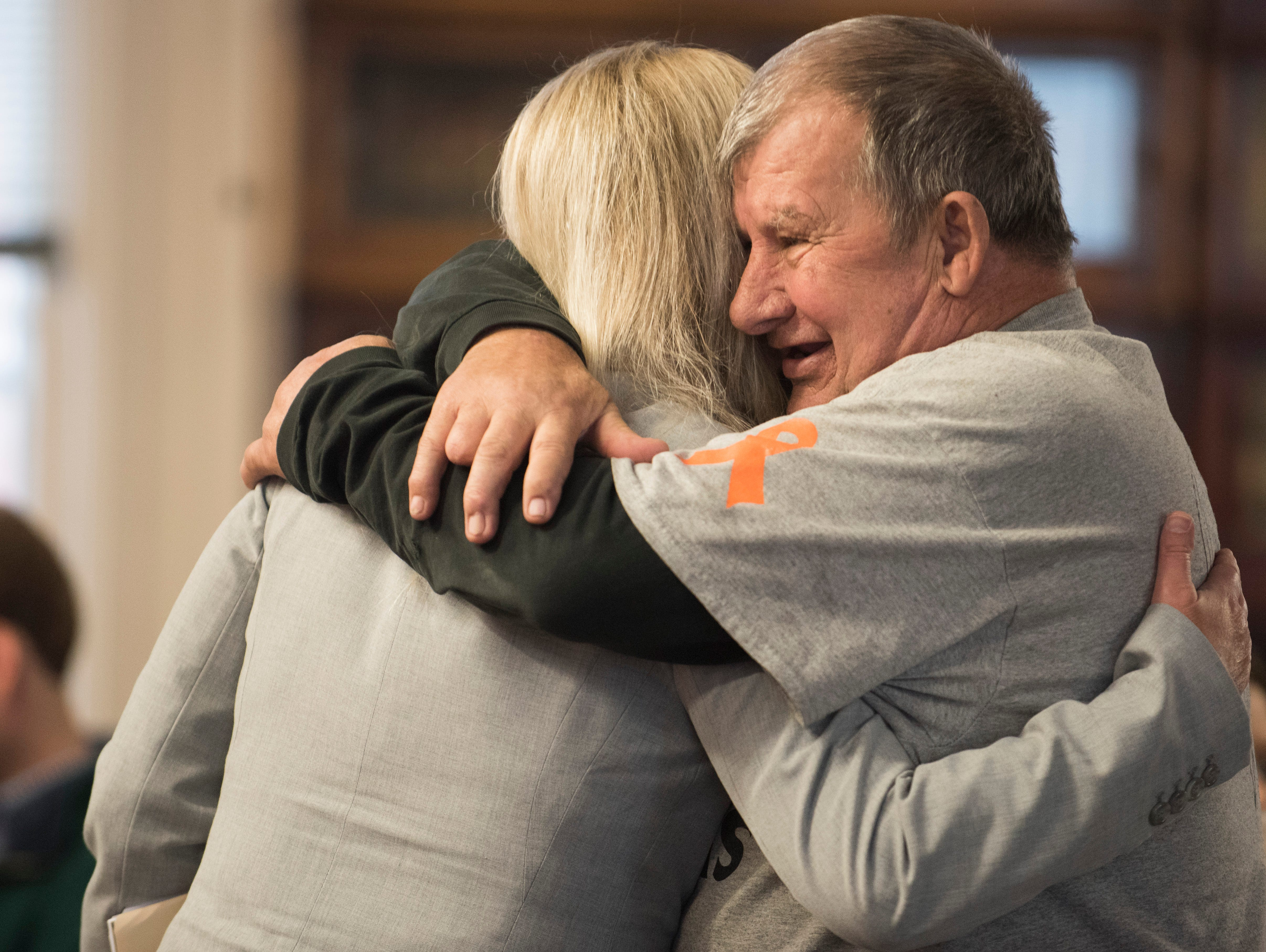 "Leonard Manley, father of Dana Manley Rhoden, hugs Special Prosecutor Angie Canepa before the arraignment of Angela Wagner at the Pike County Courthouse on Thursday, November 29, 2018 in Waverly, Ohio. Angela Wagner is facing murder chargers, along with her husband George ""Billy"" Wagner III and sons Edward ""Jake"" Wagner and George Wagner IV, relating to the deaths of seven Rhoden family members and Hannah Gilley over a possible custody dispute. The eight homicides took place in April of 2016 at four different homes, all around the same time, and it would spawn the largest homicide investigation in Ohio history. If convicted, all are facing the death penalty."