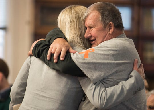 Leonard Manley, father of Dana Manley Rhoden, hugs Special Prosecutor Angie Canepa before the arraignment of Angela Wagner at the Pike County Courthouse on Thursday, November 29, 2018 in Waverly, Ohio.