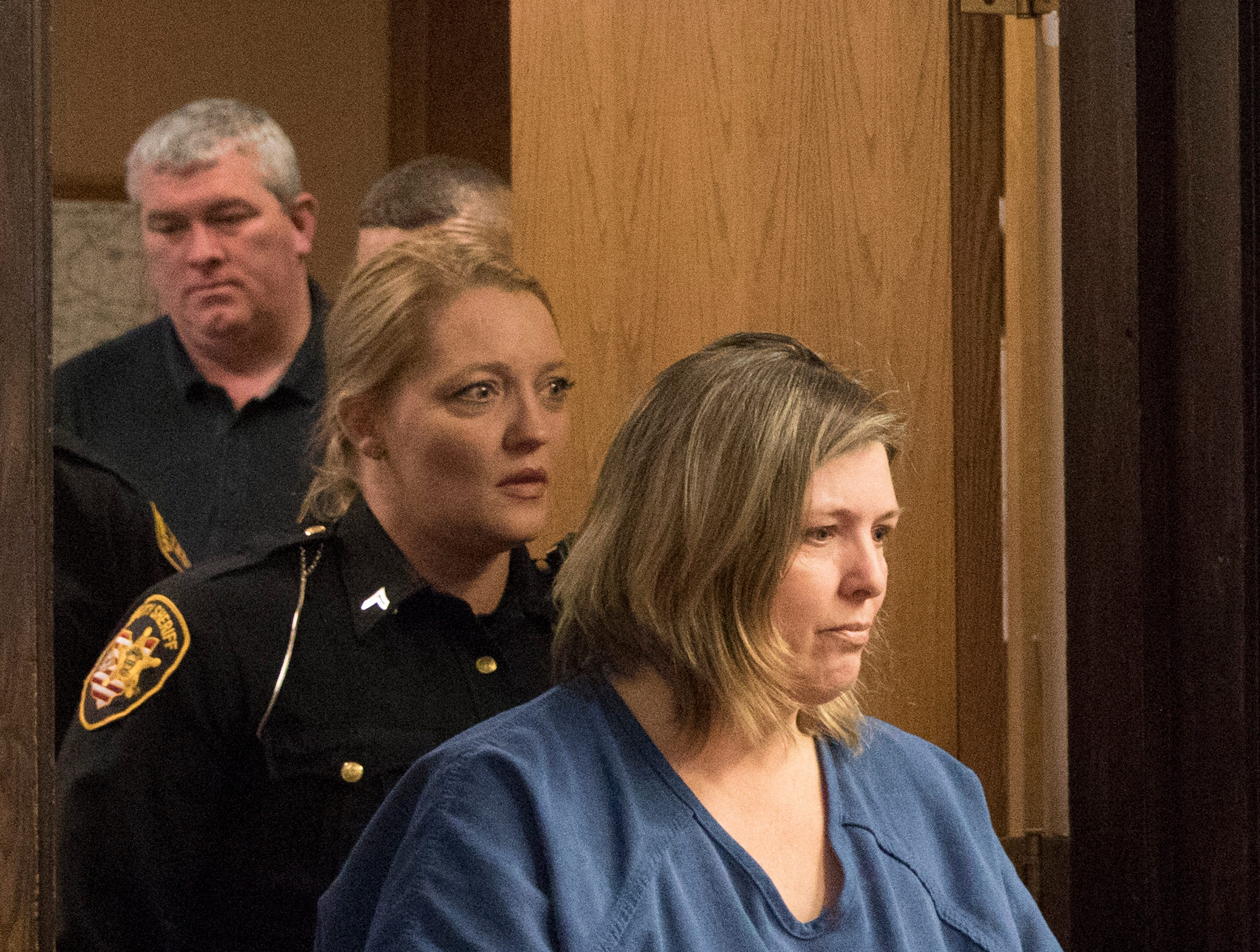 "Angela Wagner, 48, of South Webster, is escorted by female deputies into Judge Randy Deering's court for her arraignment at the Pike County Courthouse on Thursday, November 29, 2018 in Waverly, Ohio. Angela Wagner is facing murder chargers, along with her husband George ""Billy"" Wagner III and sons Edward ""Jake"" Wagner and George Wagner IV, relating to the deaths of seven Rhoden family members and Hannah Gilley over a possible custody dispute. The eight homicides took place in April of 2016 at four different homes, all around the same time, and it would spawn the largest homicide investigation in Ohio history. If convicted, all are facing the death penalty."