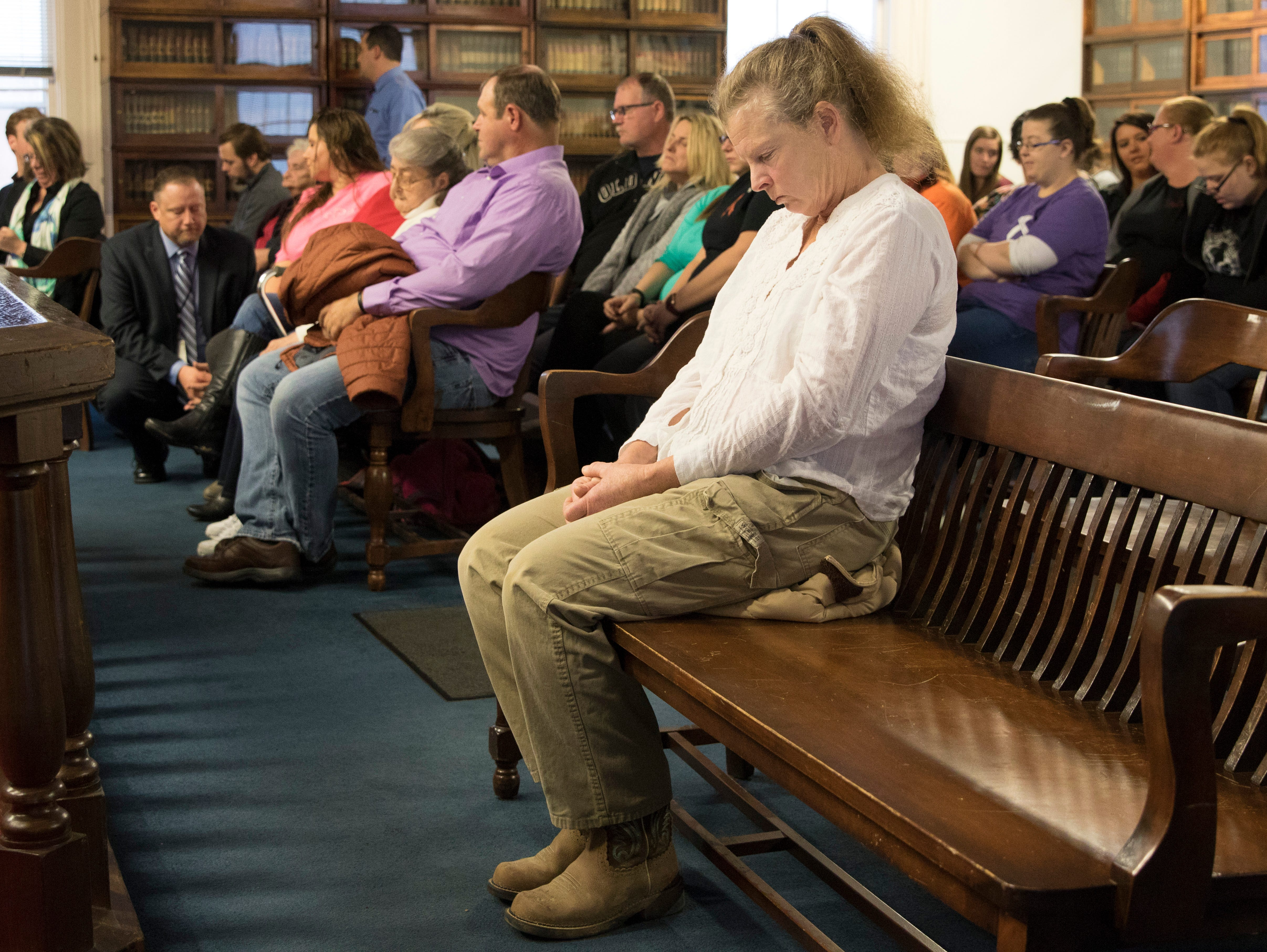 "A Wagner family member sits alone during Edward ""Jake"" Wagner's arraignment on Tuesday, November 27, 2018, in Waverly, Ohio. Jake Wagner is facing murder charges, along with his brother George Wagner IV and parents George ""Billy"" Wagner III and Angela Wagner, relating to the deaths of seven Rhoden family members and Hannah Gilley over a possible custody dispute.  Jake Wagner is the father of Hannah Rhoden's older daughter and possibly her youngest child. The eight homicides took place in April of 2016 at four different homes, all around the same time, and it would spawn the largest homicide investigation in Ohio history. If convicted, all are facing the death penalty."