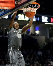 Xavier Musketeers guard Keonte Kennedy (11) dunks in the second half of an NCAA college basketball game  against the Miami (Oh) Redhawks, Wednesday, Nov. 28, 2018, at Cintas Center in Cincinnati.