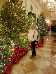 Cincinnati area florist Vickie Wenstrup admiring decorated trees in the White House.