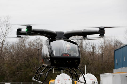 Test Pilot John Graber flies the SureFly Helicopter, a prototype aircraft by Workhorse, on Thursday, Nov. 29, 2018. The prototype is completely electric and uses 8 electric motors to fly.