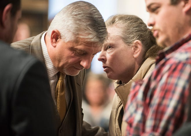 """A Wagner family member whispers to defense attorney Robert Krapenc after the arraignment of Angela Wagner at the Pike County Courthouse for her arraignment on Thursday, November 29, 2018. Angela Wagner is facing murder chargers, along with her husband George """"Billy"""" Wagner III and sons Edward """"Jake"""" Wagner and George Wagner IV, relating to the deaths of seven Rhoden family members and Hannah Gilley over a possible custody dispute."""