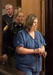 Angela Wagner, 48, of South Webster, is escorted by  deputies into Judge Randy DeeringÕs court for her arraignment at the Pike County Courthouse on Thursday, November 29, 2018  Angela Wagner is facing murder chargers, along with her husband and sons relating to the deaths of seven Rhoden family members and Hannah Gilley over a possible custody dispute. The eight homicides took place in April of 2016 at four different homes, all around the same time, and it would spawn the largest homicide investigation in Ohio history.