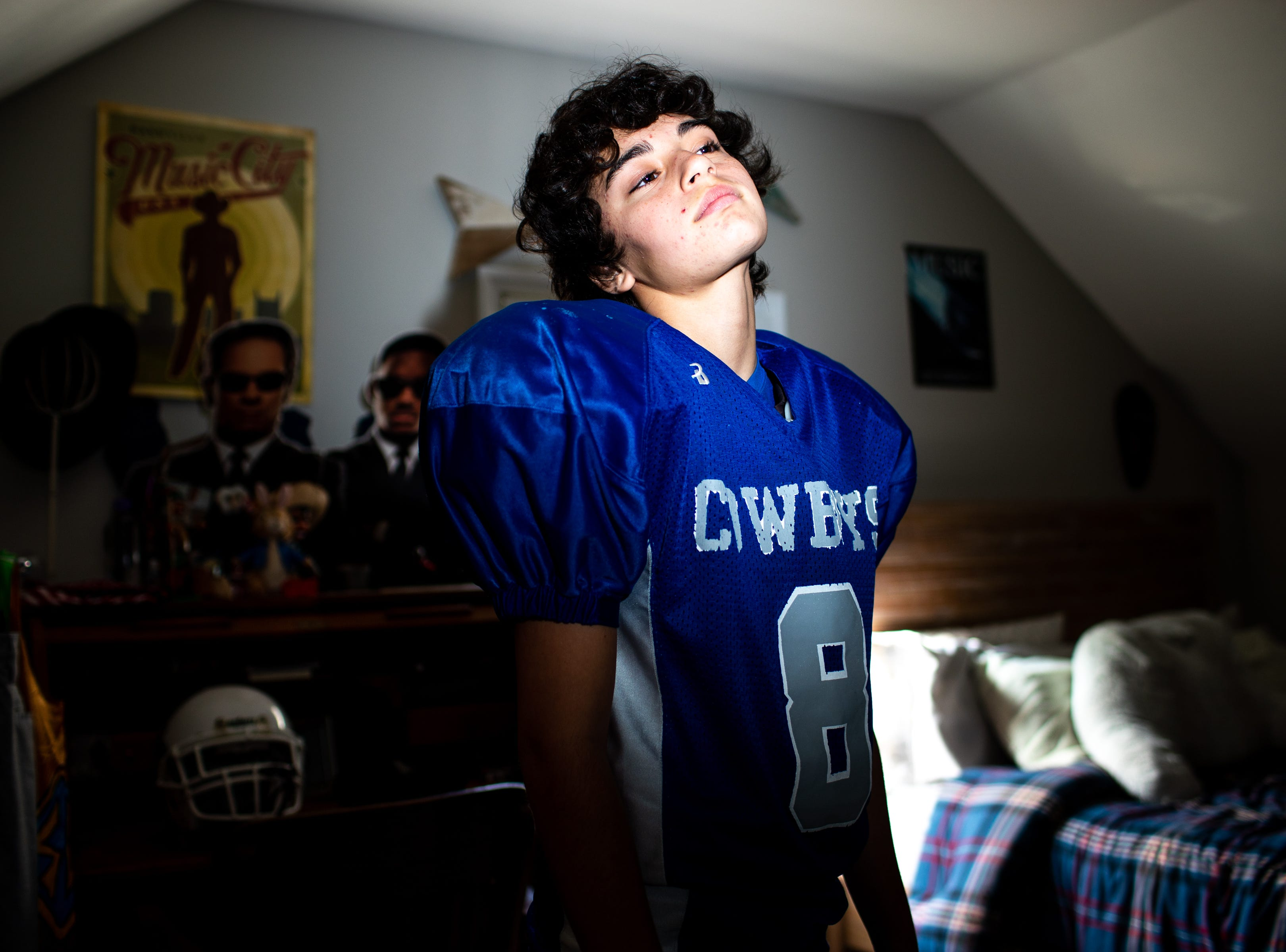 Richview Middle School Cowboys cornerback Ari Grimes, 14, poses for a portrait in his uniform at their home Saturday, Nov. 3, 2018, in Clarksville, Tenn.