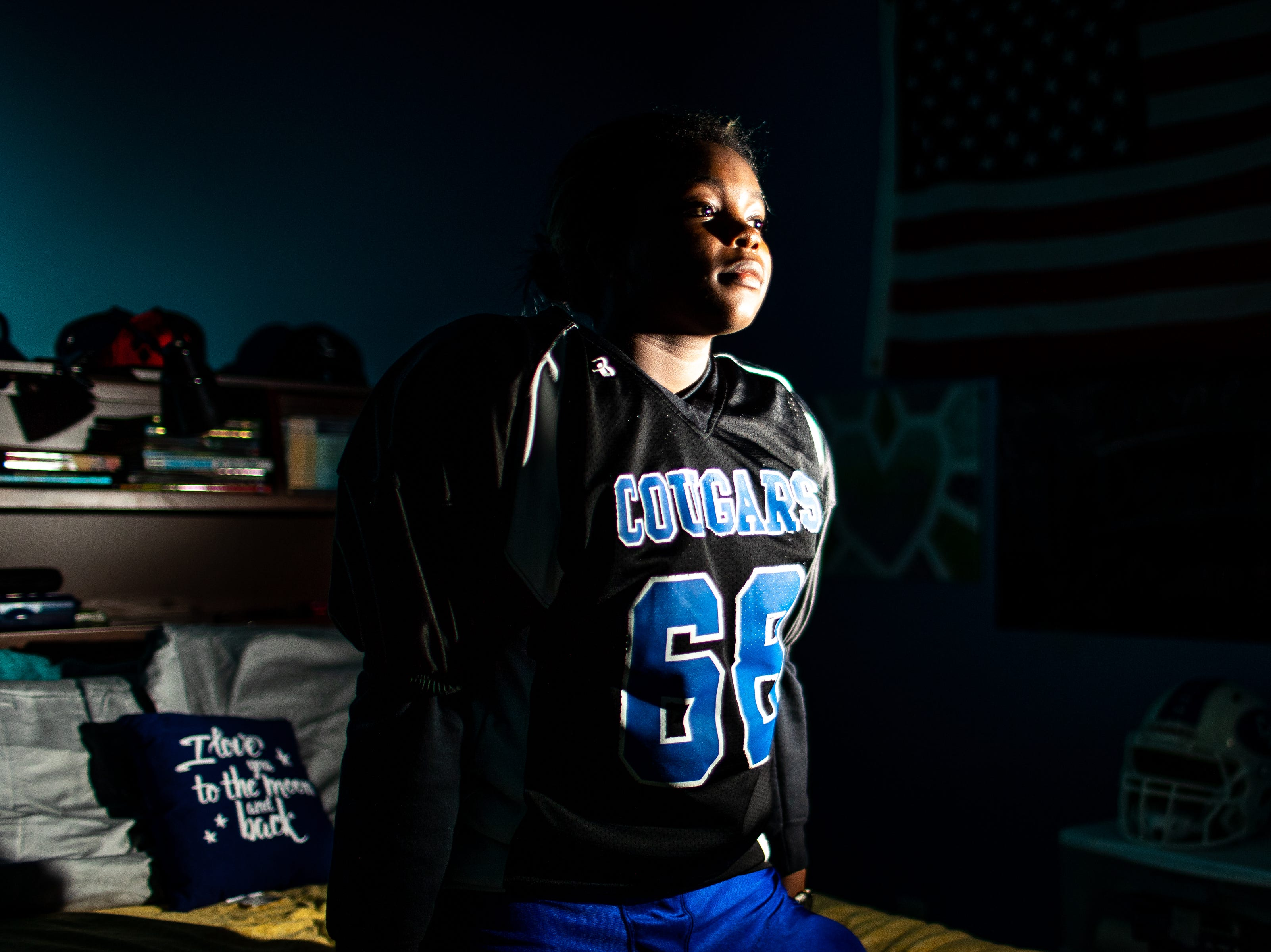 Clarksville Academy Cougars nose guard Madisen Bryant, 13, poses for a portrait in their uniform at their home Friday, Nov. 16, 2018, in Clarksville, Tenn.