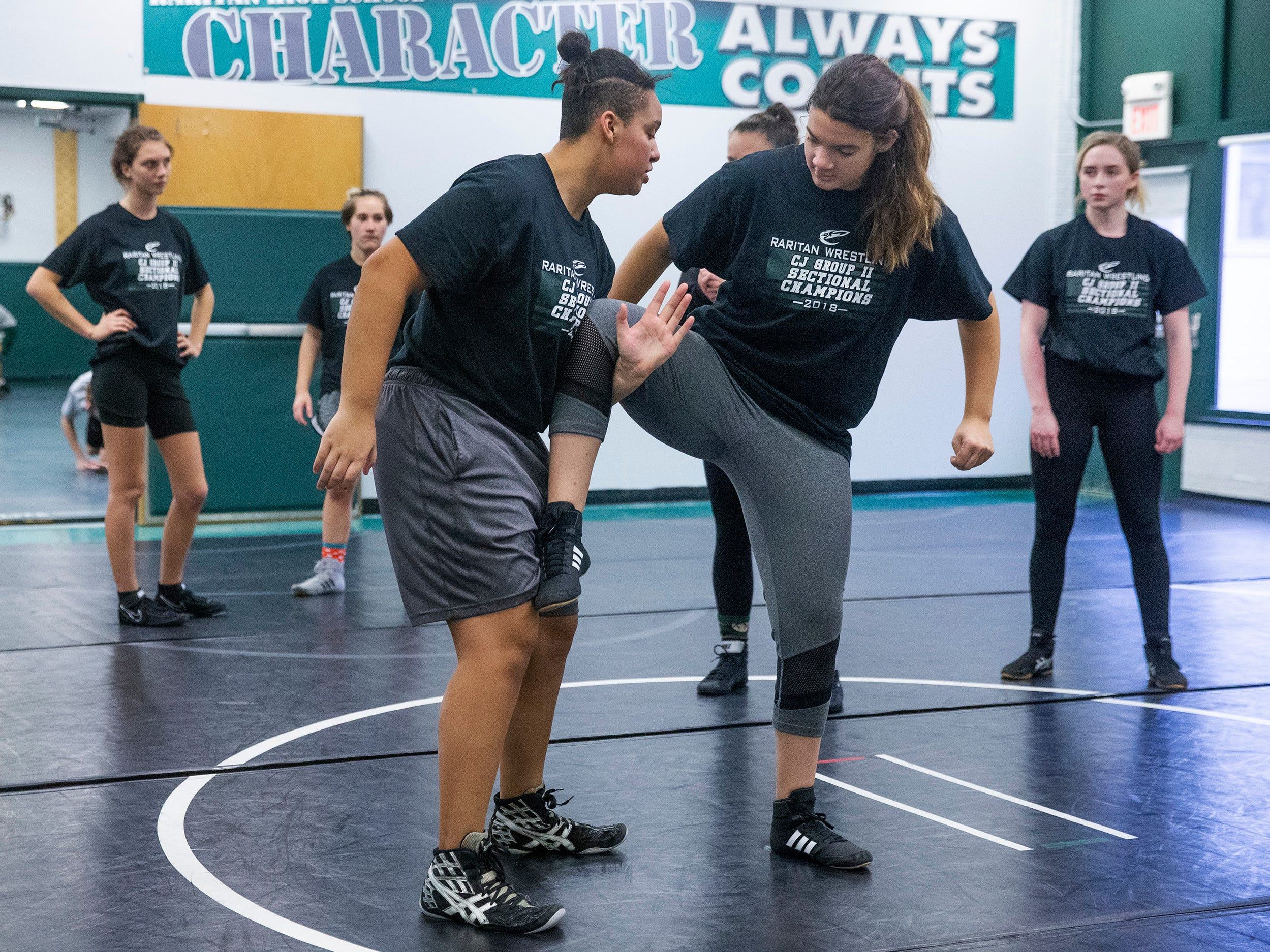 NJSIAA is offering wrestling for girls this year and they will participate in an all girls tournament at the end of the season. Raritan High School Wrestling is fielding nearly a  full girls team this year. While girls mostly practice separately from the boys, they are in a room next to the boys and frequent coaching sessions happen in the boys room to teach moves.