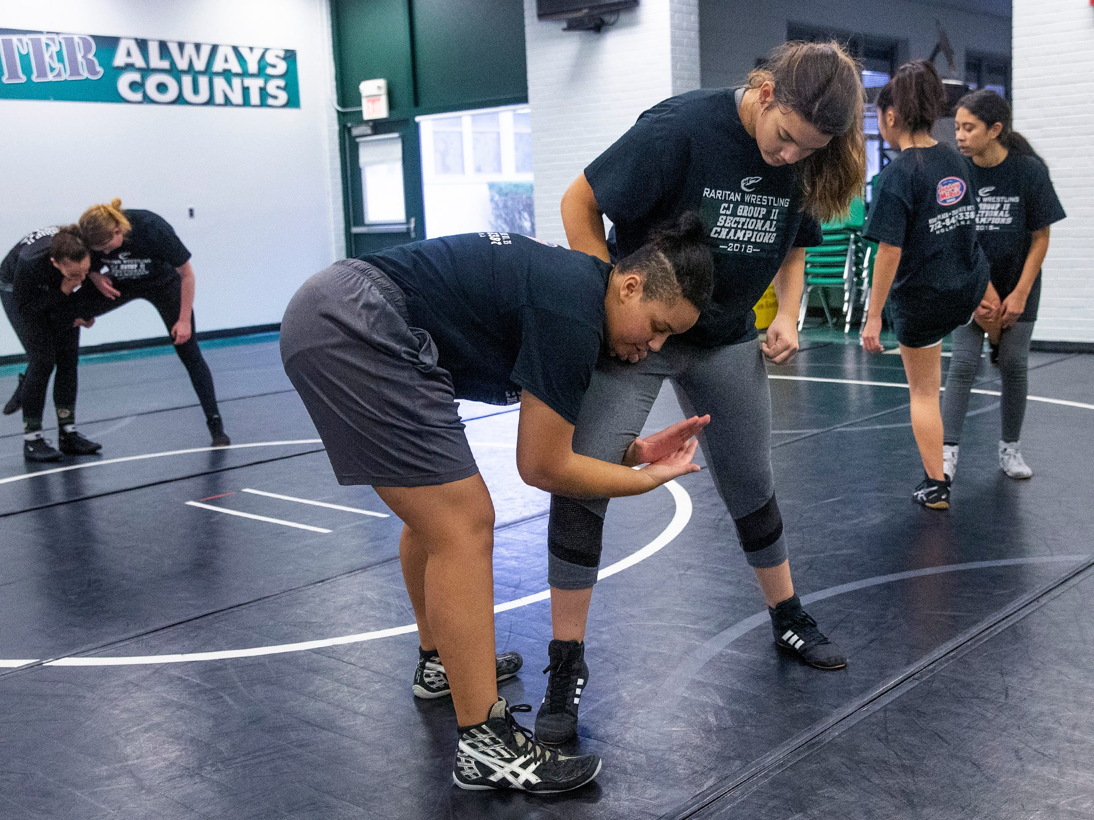Mia Lazaurs and Gianna Seeley work on wizarNJSIAA is offering wrestling for girls this year and they will participate in an all girls tournament at the end of the season. Raritan High School Wrestling is fielding nearly a  full girls team this year. While girls mostly practice separately from the boys, they are in a room next to the boys and frequent coaching sessions happen in the boys room to teach moves.