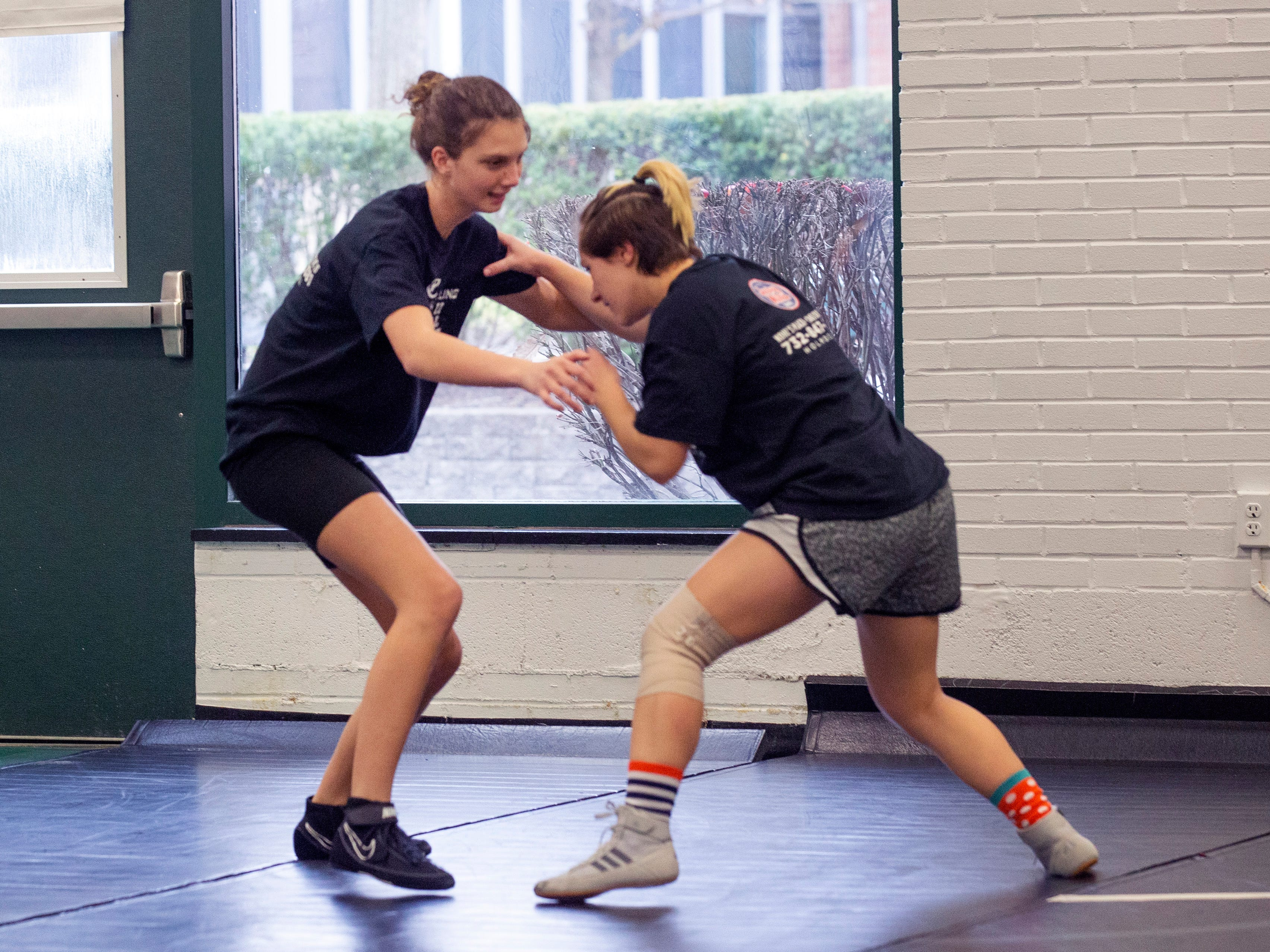 Casandra Auletta, and Christine Gravasheti work on their takedown technique. NJSIAA is offering wrestling for girls this year and they will participate in an all girls tournament at the end of the season. Raritan High School Wrestling is fielding nearly a  full girls team this year. While girls mostly practice separately from the boys, they are in a room next to the boys and frequent coaching sessions happen in the boys room to teach moves.