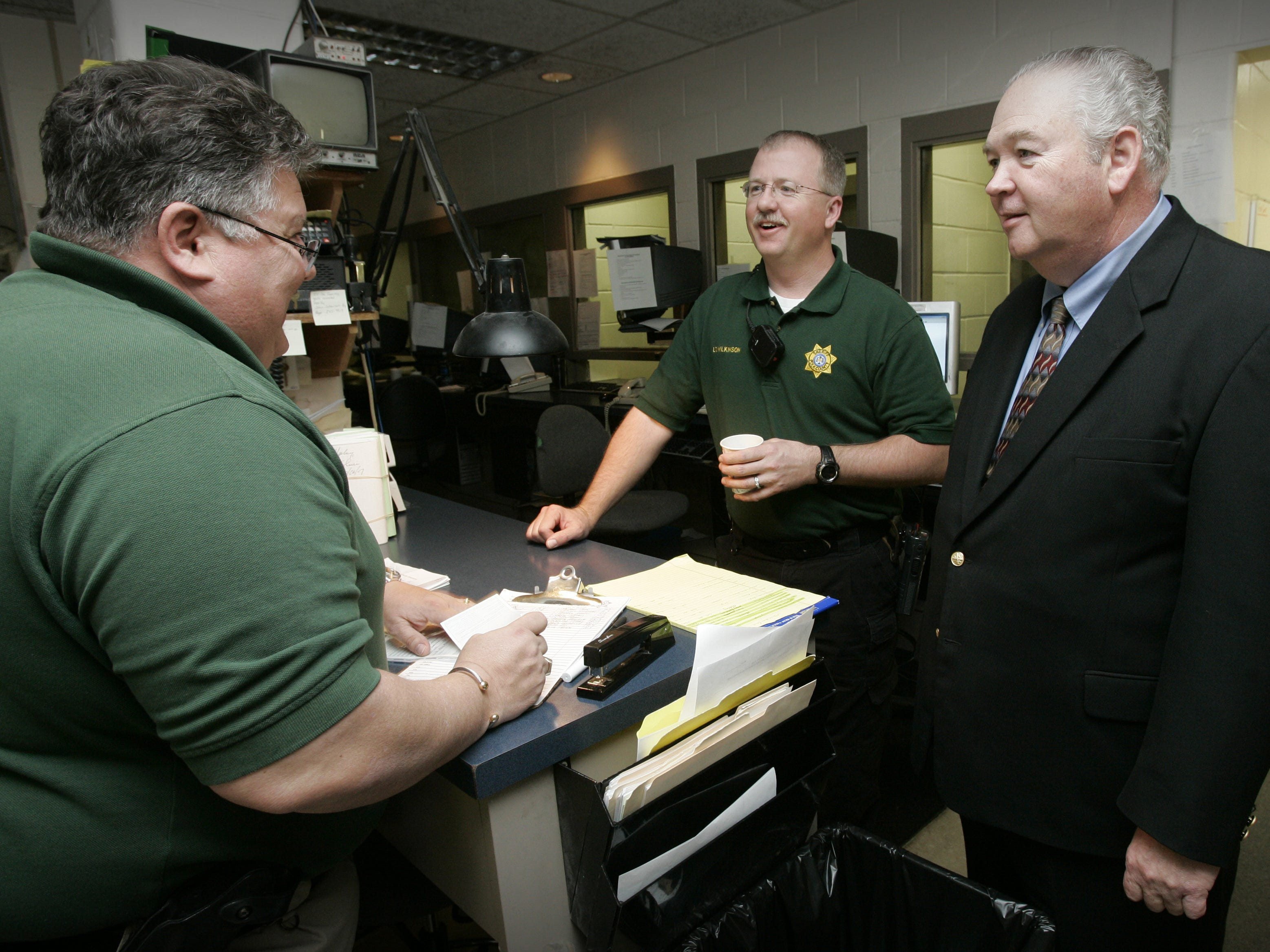 Polk County Jail Chief Sheriff's Deputy Bill McCarthy, right, Sgt. Craig Matzke, left, and Lt. Jeff Wilkinson, center, at the Polk County Jail on March 26,  2007 in Des Moines.