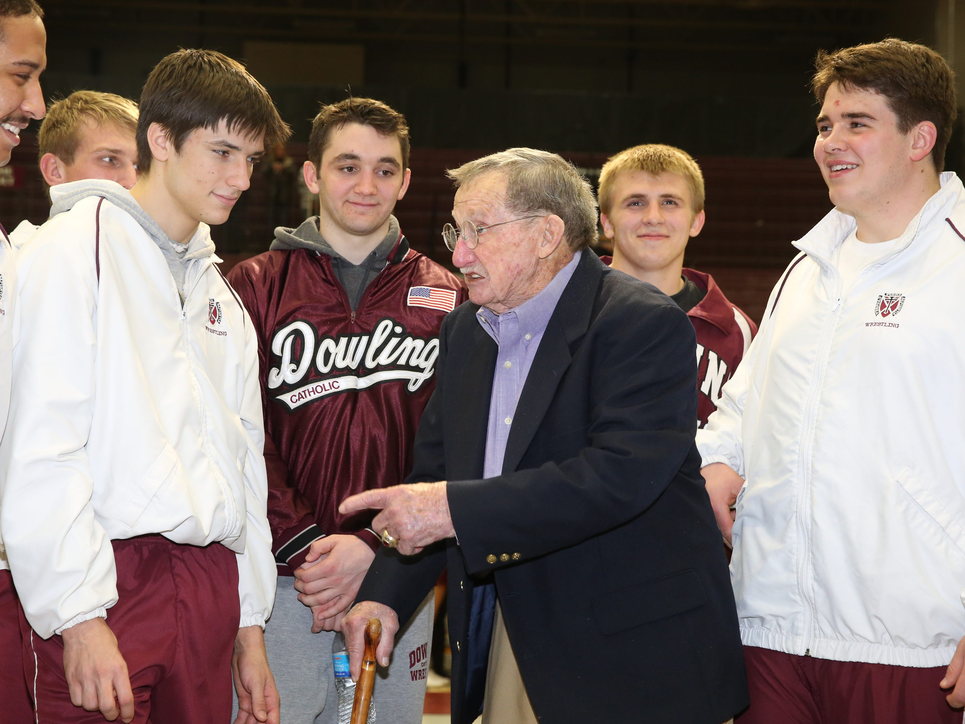 From 2015: Legendary wrestling Bob Darrah was honored before the Dowling vs. Urbandale wrestling match held at Dowling Catholic High School. The wrestling room was dedicated in his honor. Darrah gives the Dowling wrestlers a few tips before the match.
