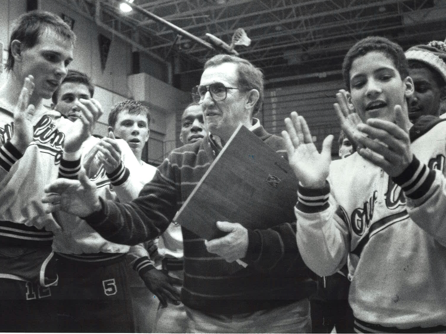 From 1989: Dowling wrestling coach Bob Darrah with a plaque honoring him as the state's winningest high school wrestling coach.