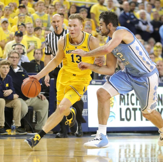 Michigan forward Ignas Brazdeikis drives against North Carolina forward Luke Maye during the second half of U-M's 84-67 win on Wednesday, Nov. 28, 2018, at Crisler Center.