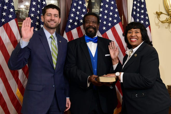 House Speaker Paul Ryan of Wis., left, poses for a photo during a ceremonial swearing-in of Rep.-elect Brenda Jones, D-Mich., right, as John Pitts, center, holds the Bible on Capitol Hill in Washington, Thursday, Nov. 29, 2018.