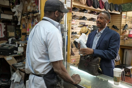 Owner Andy Campbell talks with Everett Stone, 64, of Canton who has been a longtime customer at Tip Toe Shoe Repair, a full service shoe repair shop located on Michigan avenue in downtown Detroit, photographed on Wednesday, June 6, 2018.