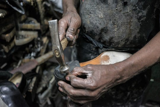 Owner Andy Campbell uses a hammer to reinforce the heel of a shoe he repairs at Tip Toe Shoe Repair, a full service shoe repair shop located on Michigan avenue in downtown Detroit, photographed on Wednesday, June 6, 2018.