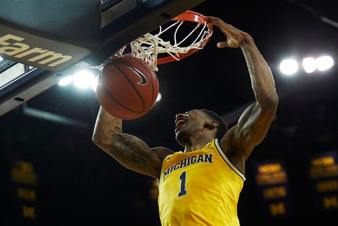 Michigan's Charles Matthews dunks in the first half against North Carolina at Crisler Center, Nov. 28, 2018.