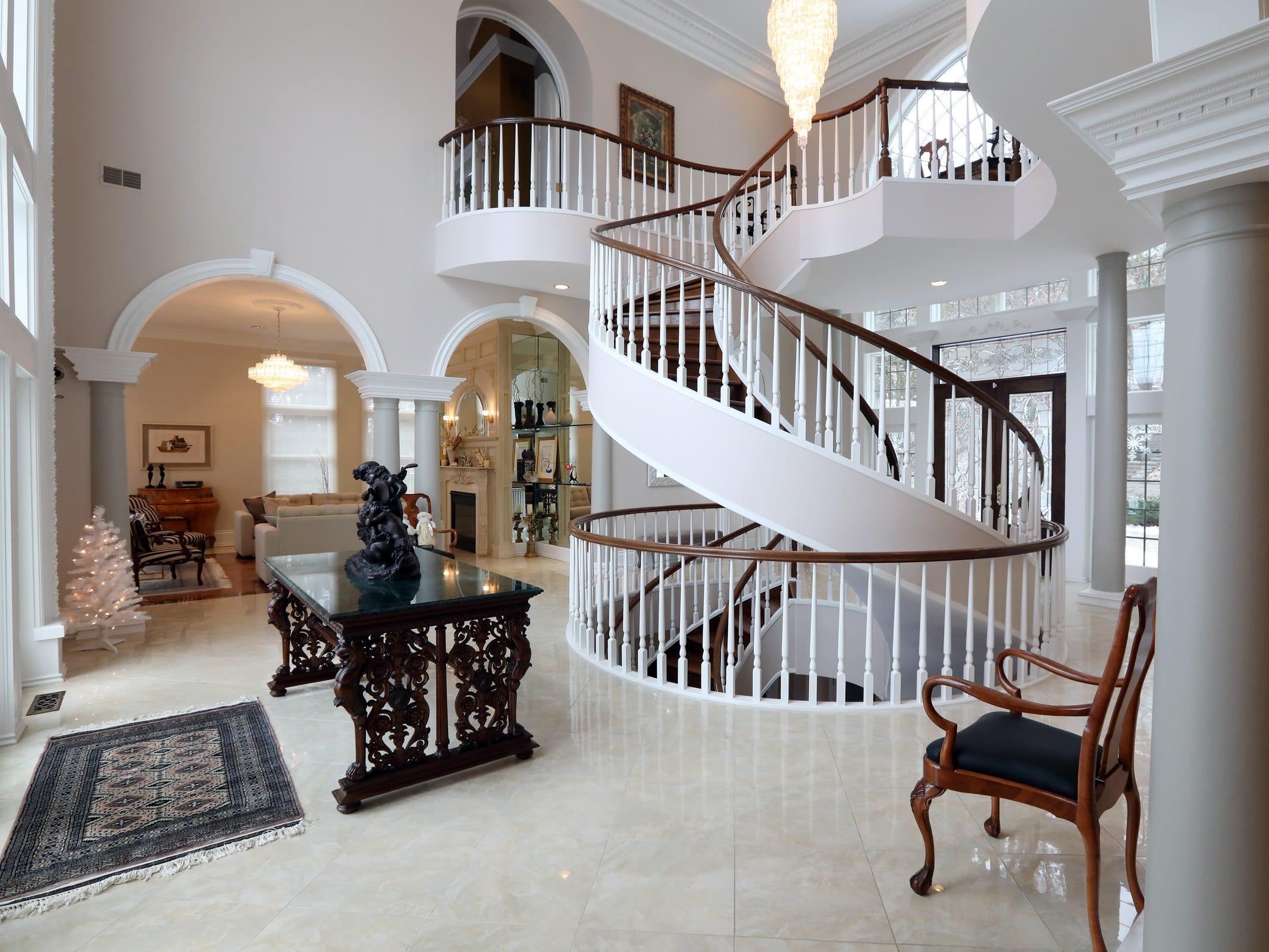 $1.5M Clarkston home has open floor plan, waterfalls, dock