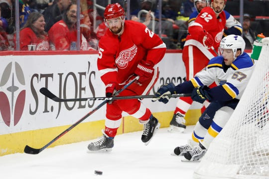 Detroit Red Wings defenseman Mike Green and St. Louis Blues left wing David Perron chase the puck during the first period at Little Caesars Arena, Nov. 28, 2018, in Detroit.