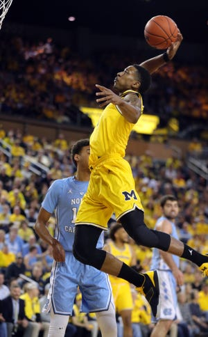 Michigan's Charles Matthews dunks against North Carolina during the first half Wednesday, Nov. 28, 2018 at the Crisler Center in Ann Arbor.