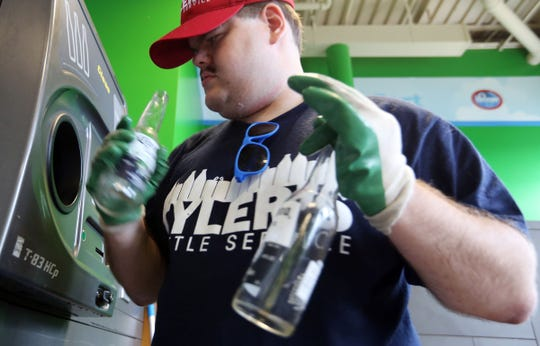 Tyler Laviolette, 23, of Waterford runs a company called Tyler's Bottle Service. Here he is recycling returnables to a local Kroger Recycle Center Tuesday, Aug. 16, 2016.