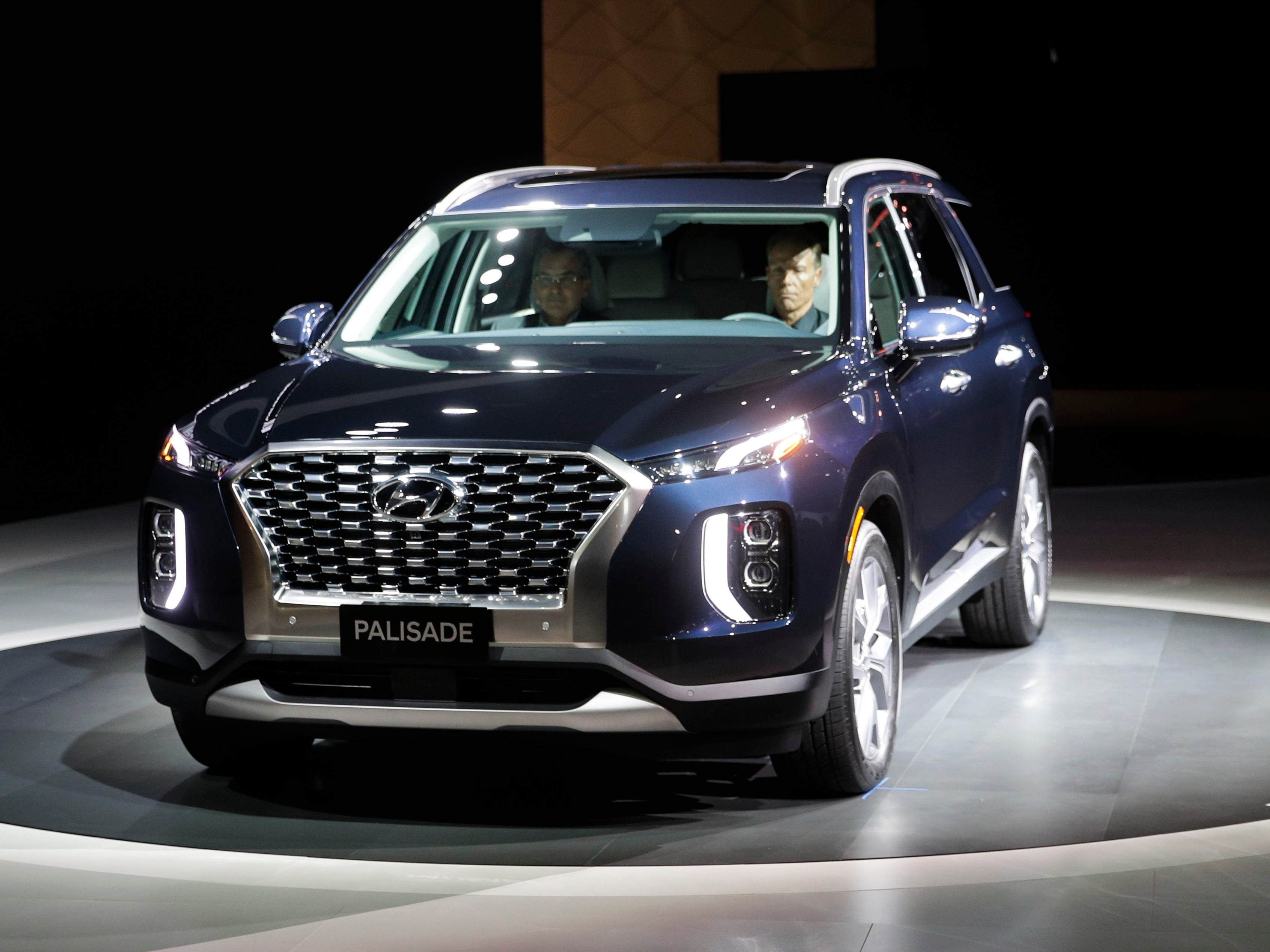 Brian Smith, left, Hyundai Motor America's COO, sits in the 2020 Hyundai Palisade to introduce the new SUV. The big Palisade expands the brand's family SUV lineup in a ute-crazed market.