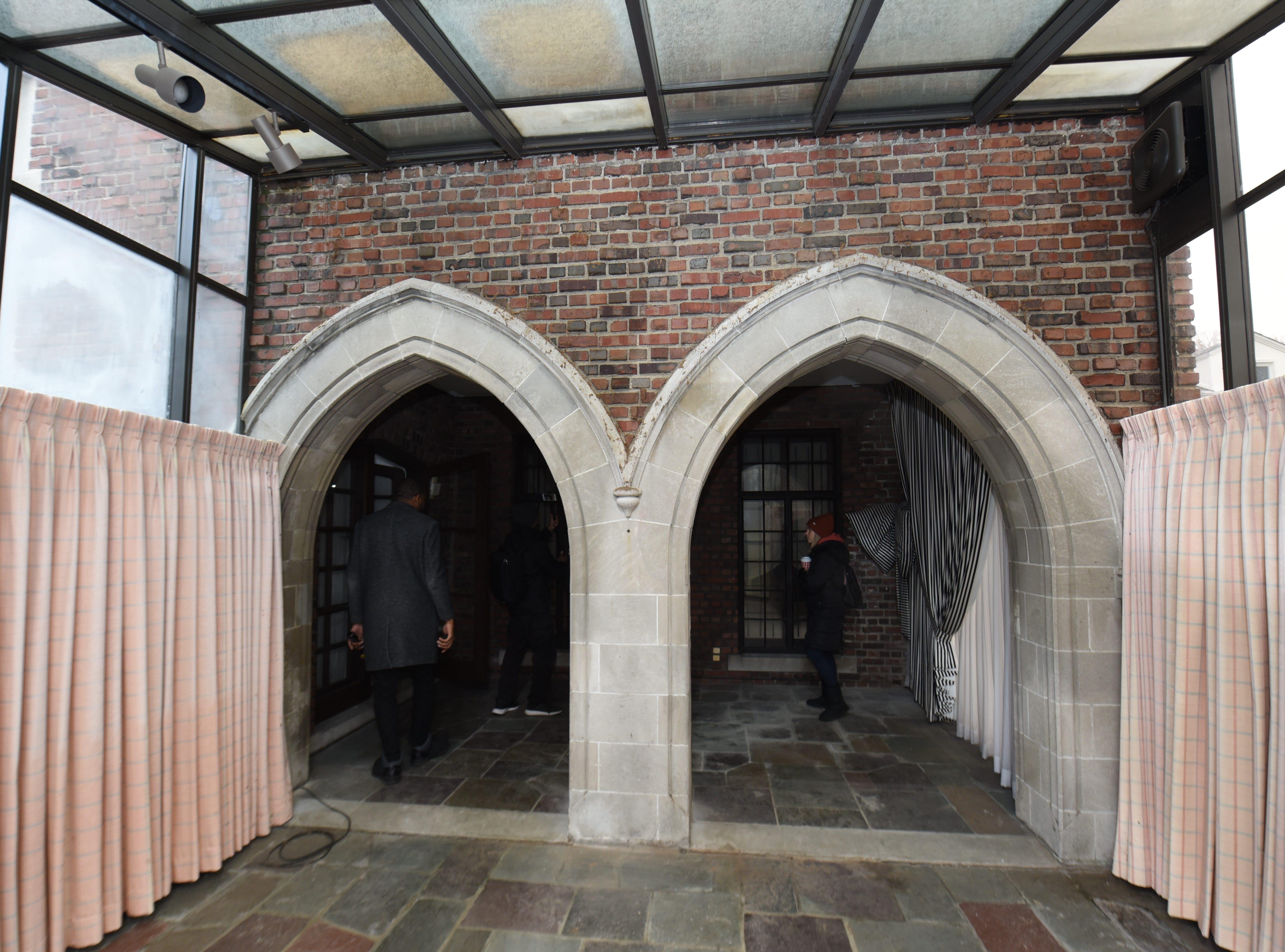 Double arches lead the way to one entrance of the home.
