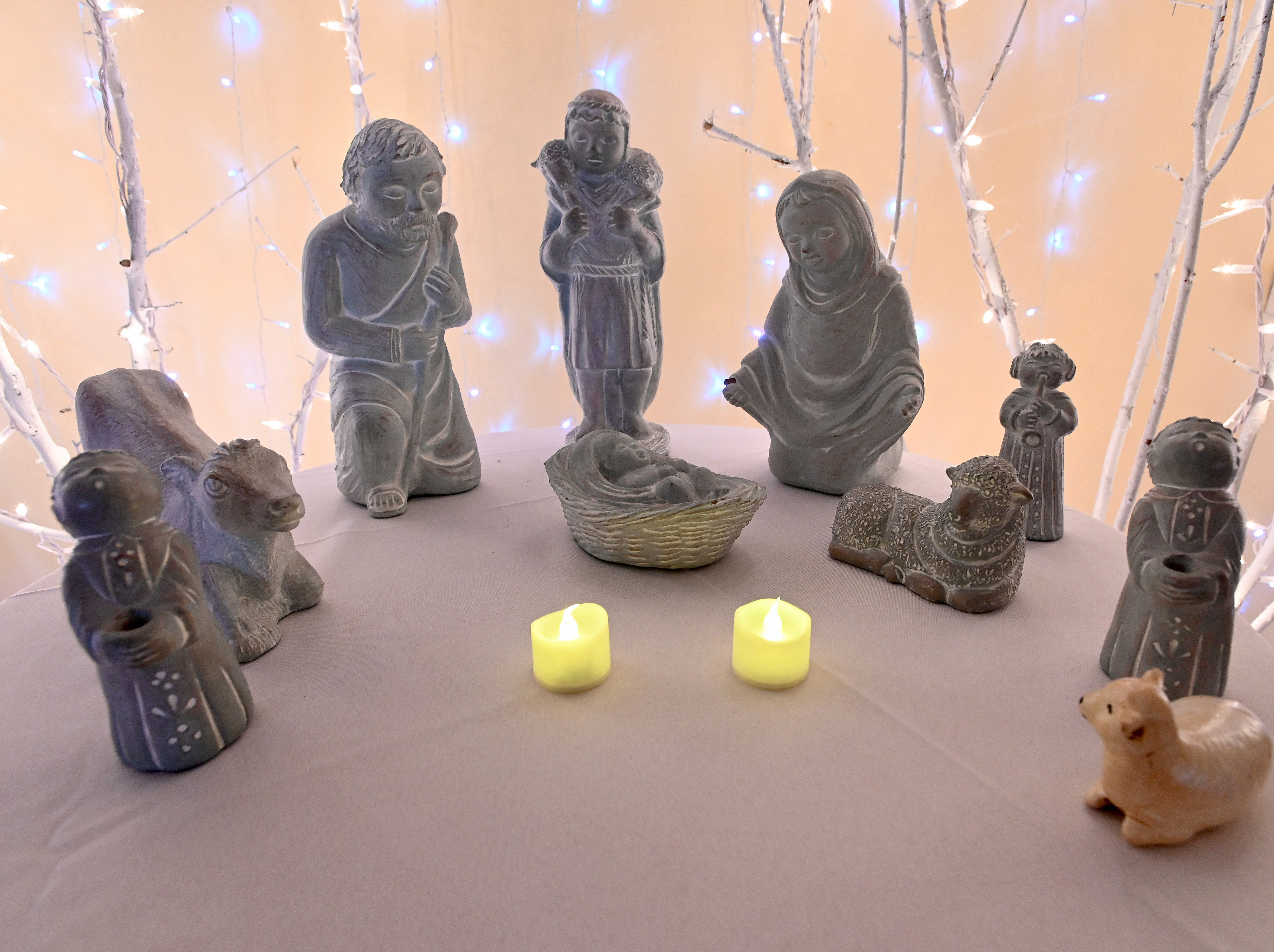 A carved nativity scene is just one of many on display, loaned by three collectors for the event.