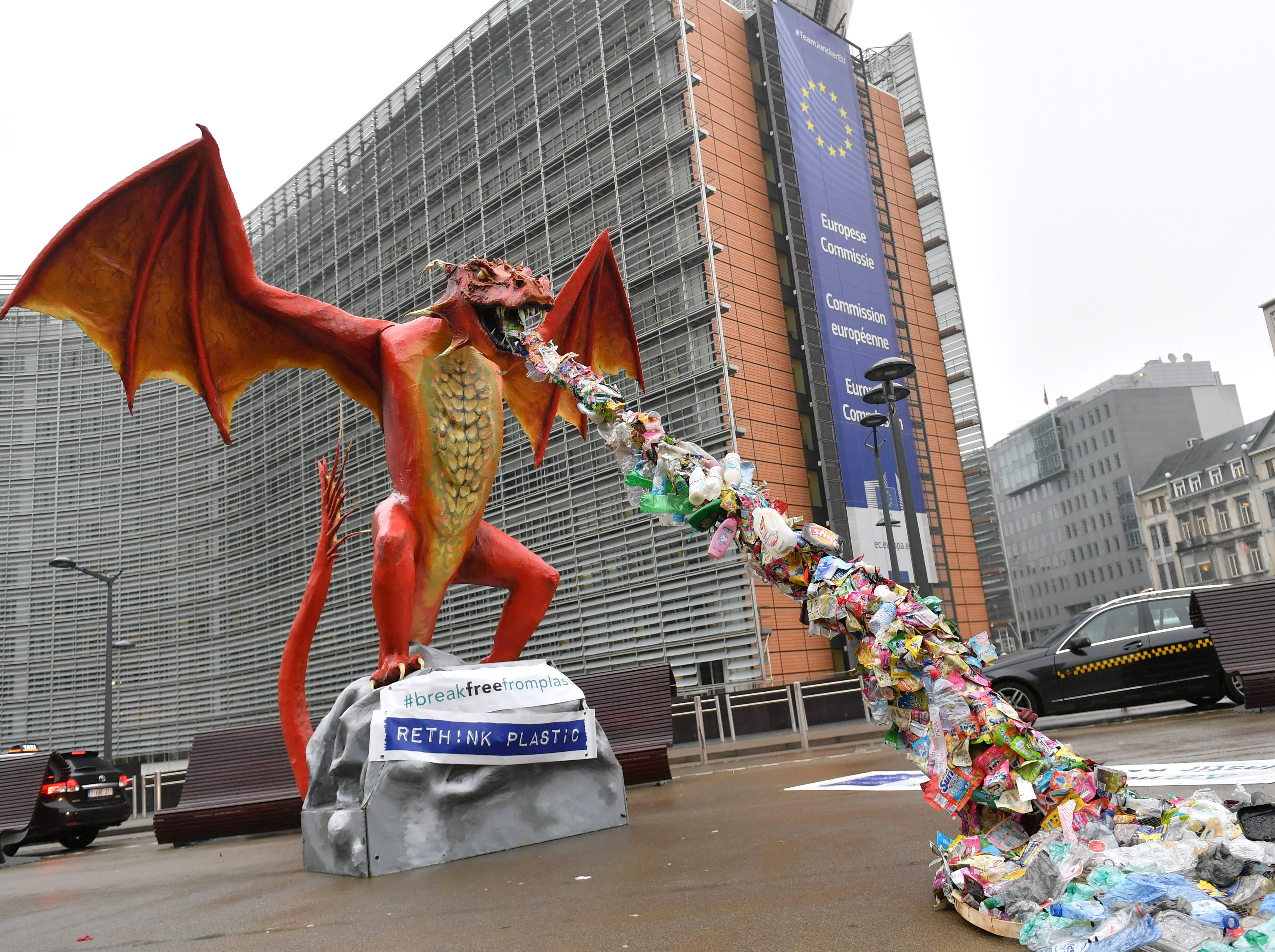 A statue depicting a plastic-throwing dragon is set up in front of the European Commission, during an action by NGO alliance Rethink Plastic to demand an end of the use of disposable plastic, in Brussels on Nov. 26, 2018. The EU adopted in January 2018 the first European Strategy for Plastics in a Circular Economy that is aimed at transforming the way plastic products are designed, used, produced and recycled in member countries.