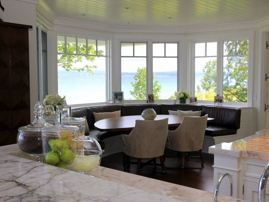 The $9.45 million, two-story home is in a gated community and has 130 feet of frontage on Lake Michigan on one side and 130 feet of frontage on Bay Harbor Lake.