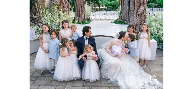 Marc Berger and Stefenie Sasson surrounded by children who stood up for the couple during the wedding in Miami.