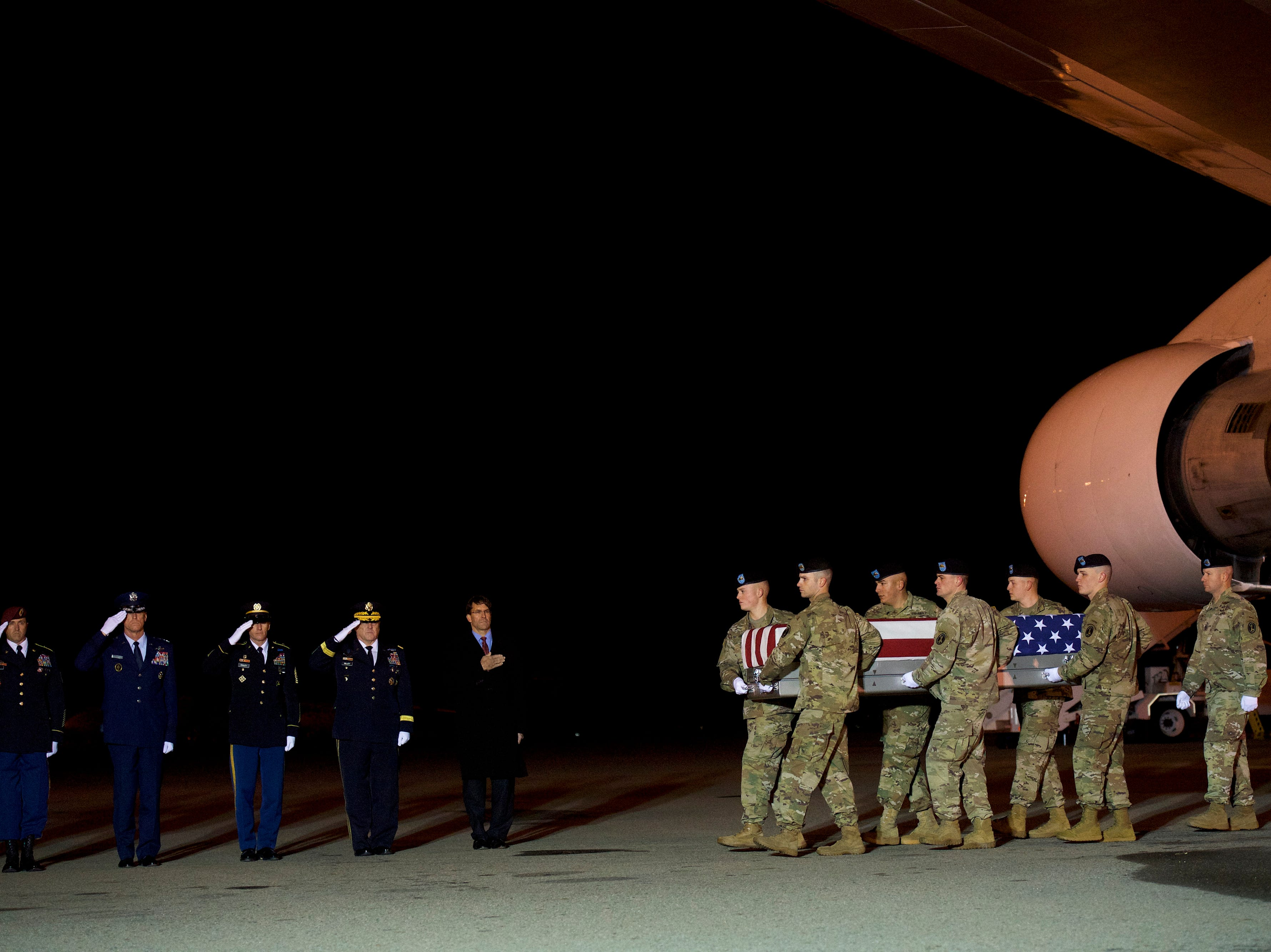 Armed forces members carry a case covered with an American flag during a dignified transfer for fallen service member Sgt. Leandro A.S. Jasso on Nov. 27, 2018 in Dover, Delaware. Jasso of Leavenworth, Washington was killed in Afghanistan while engaging enemy forces.