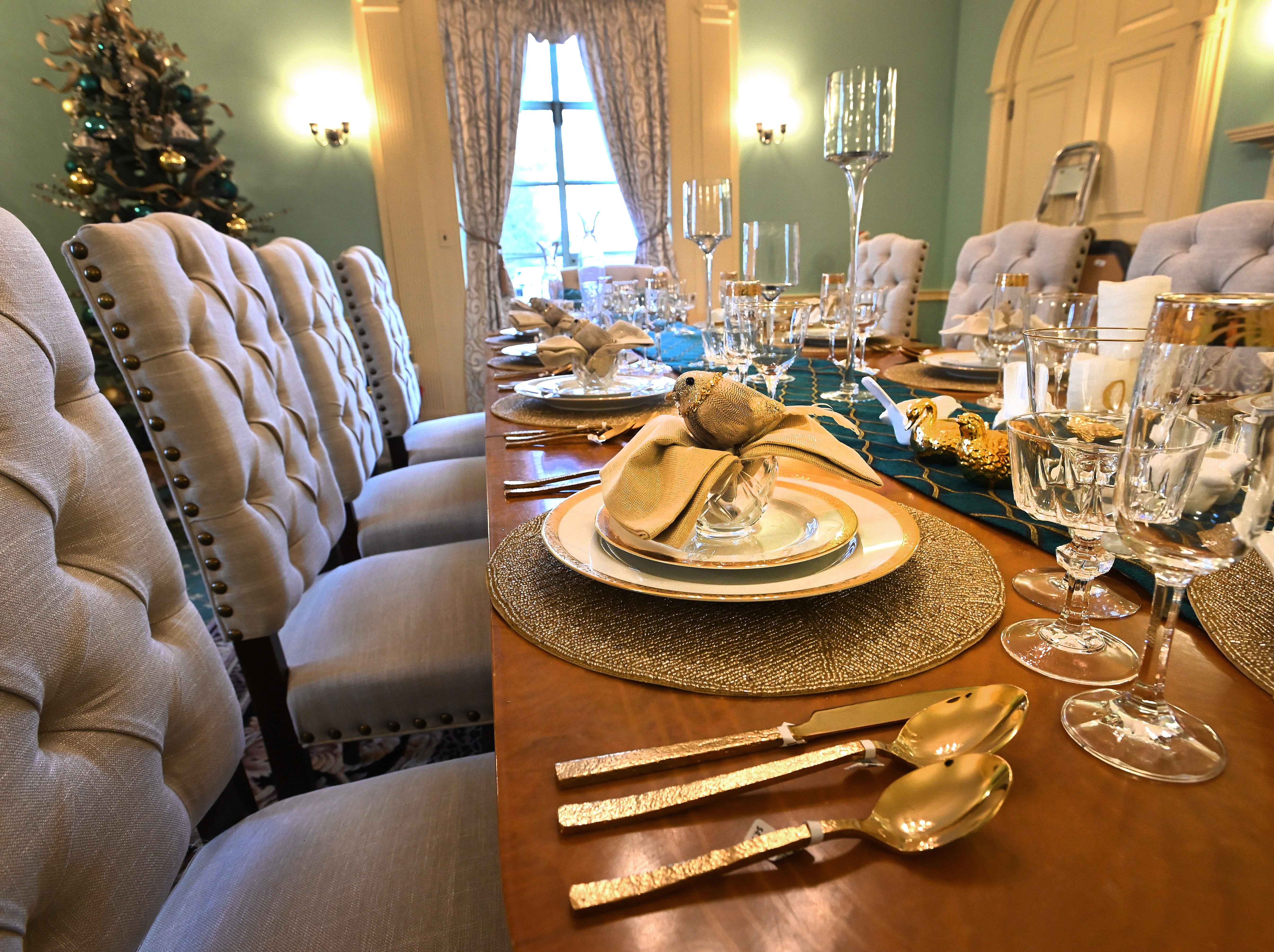 Formal finery decorates the dining table set for ten hungry guests.