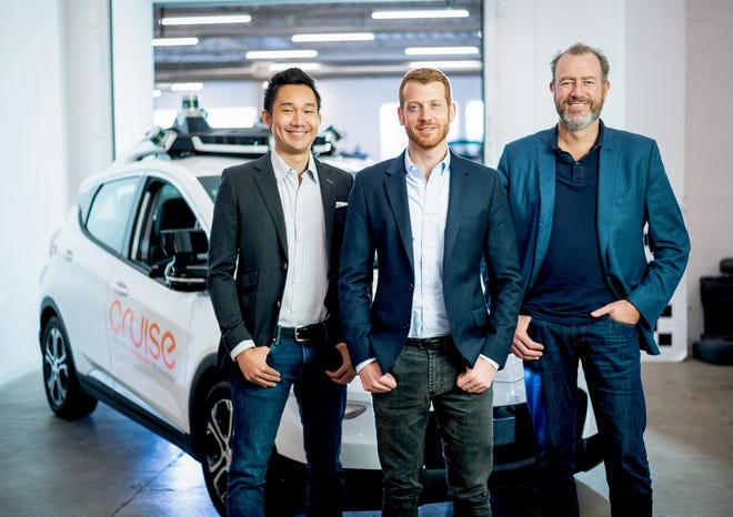 """GM Cruise LLC CEO Dan Ammann, right, is fond of saying competitors in the autonomous-vehicle space are """"in a race to the starting line."""""""