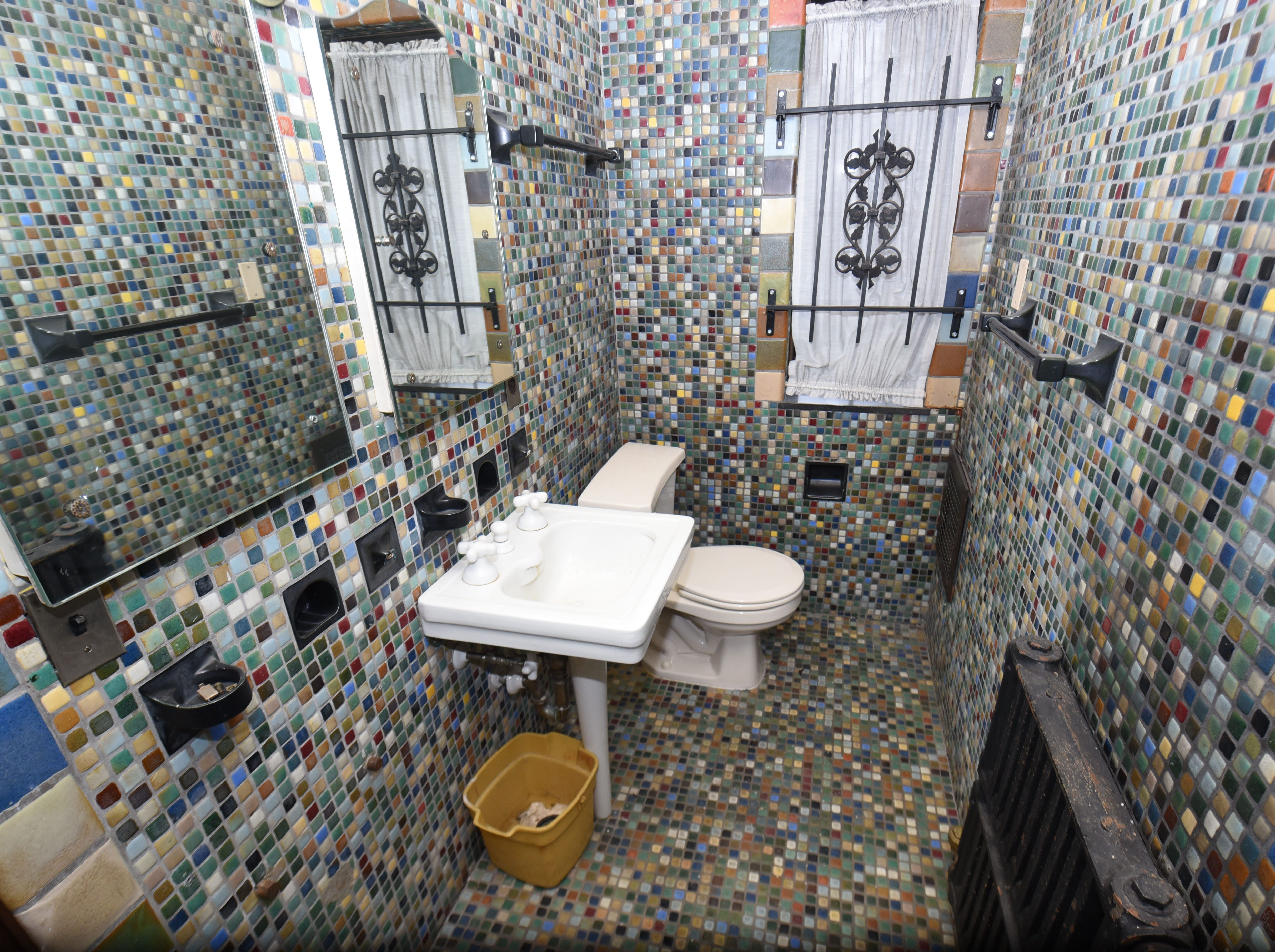 Multi-colored tiles cover an entire second floor bathroom in the former Detroit home of Aretha Franklin.