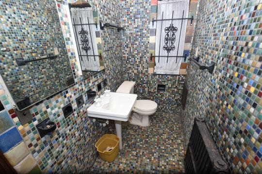 Multi-colored tiles cover an entire second-floor bathroom in the former Detroit home of Aretha Franklin.