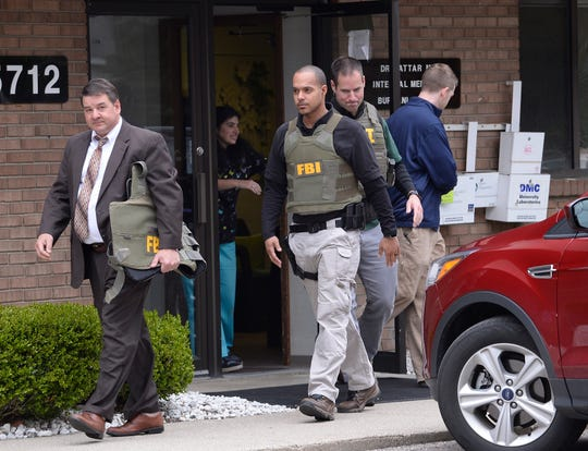 FBI agents leave the office of Dr. Fakhruddin Attar, Burhani Clinic this morning after completing a search for documents in the on going investigation of Jumana Nagarwala of Northville who is charged with female genital mutilation of two 7 year old girls. Livonia, Mi. April 21, 2017.
