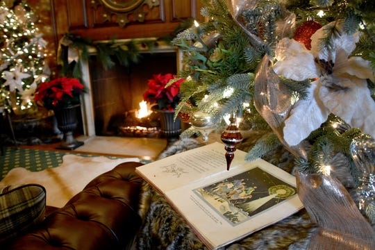 The study in Earhart Manor is staged with a peaceful holiday scene. The manor on the campus of Concordia University in Ann Arbor will be on display for visitors this weekend, Nov. 30-Dec. 2.