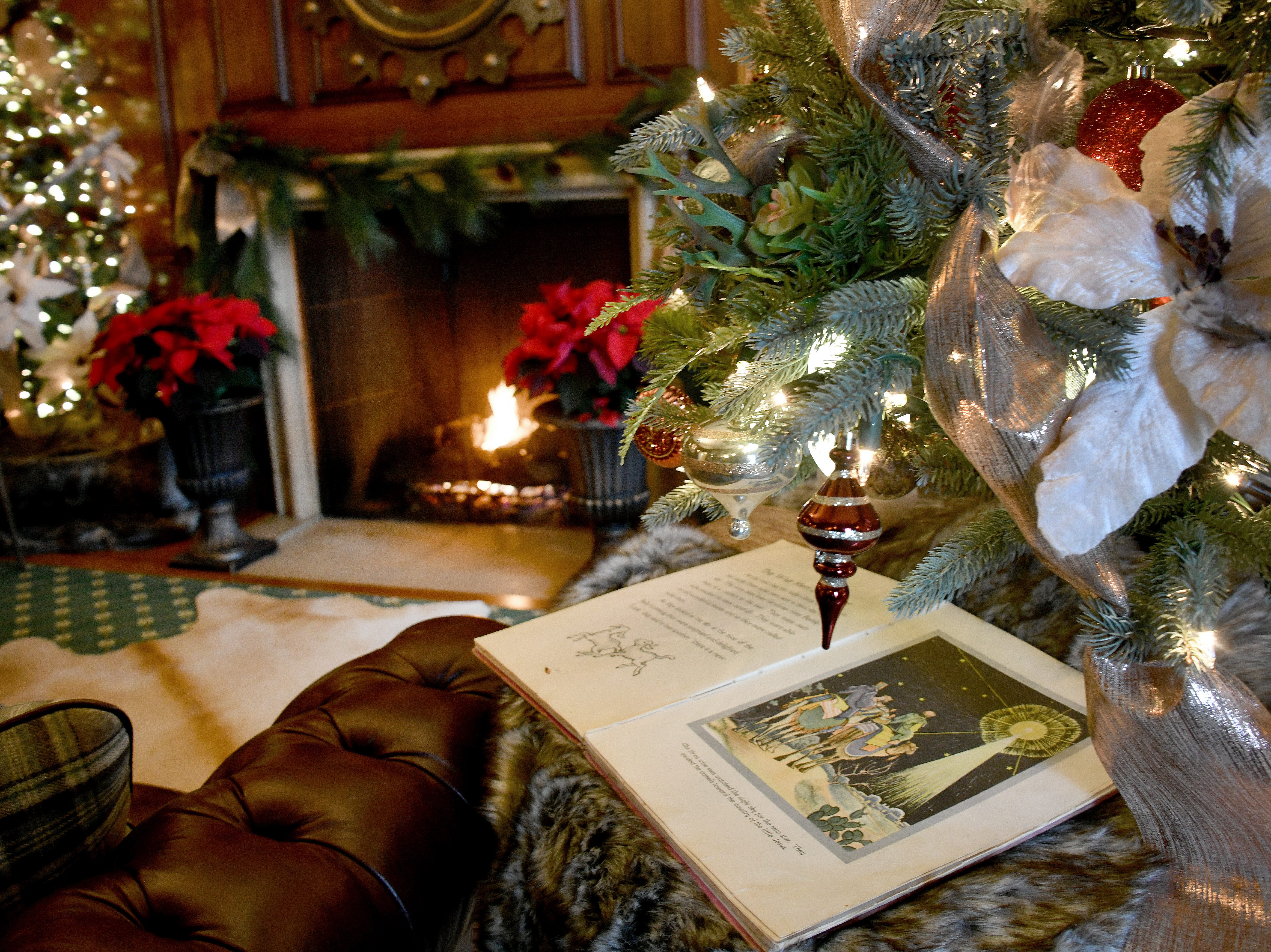 A warm fire burns in the fireplace in the where deep, cozy chairs await and Christmas reading is available for those with time to kill.