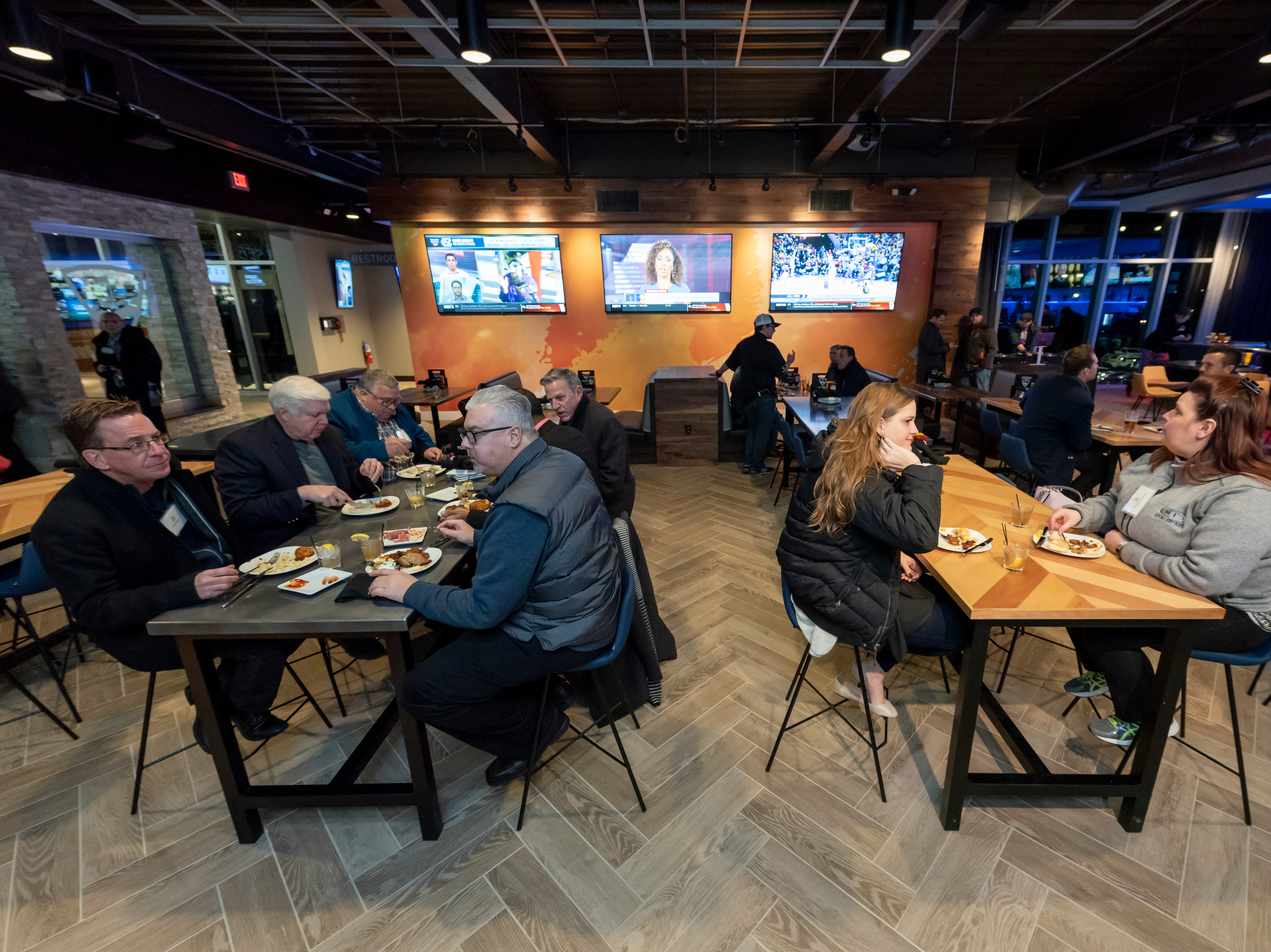 The facility includes a bar and space for private events.