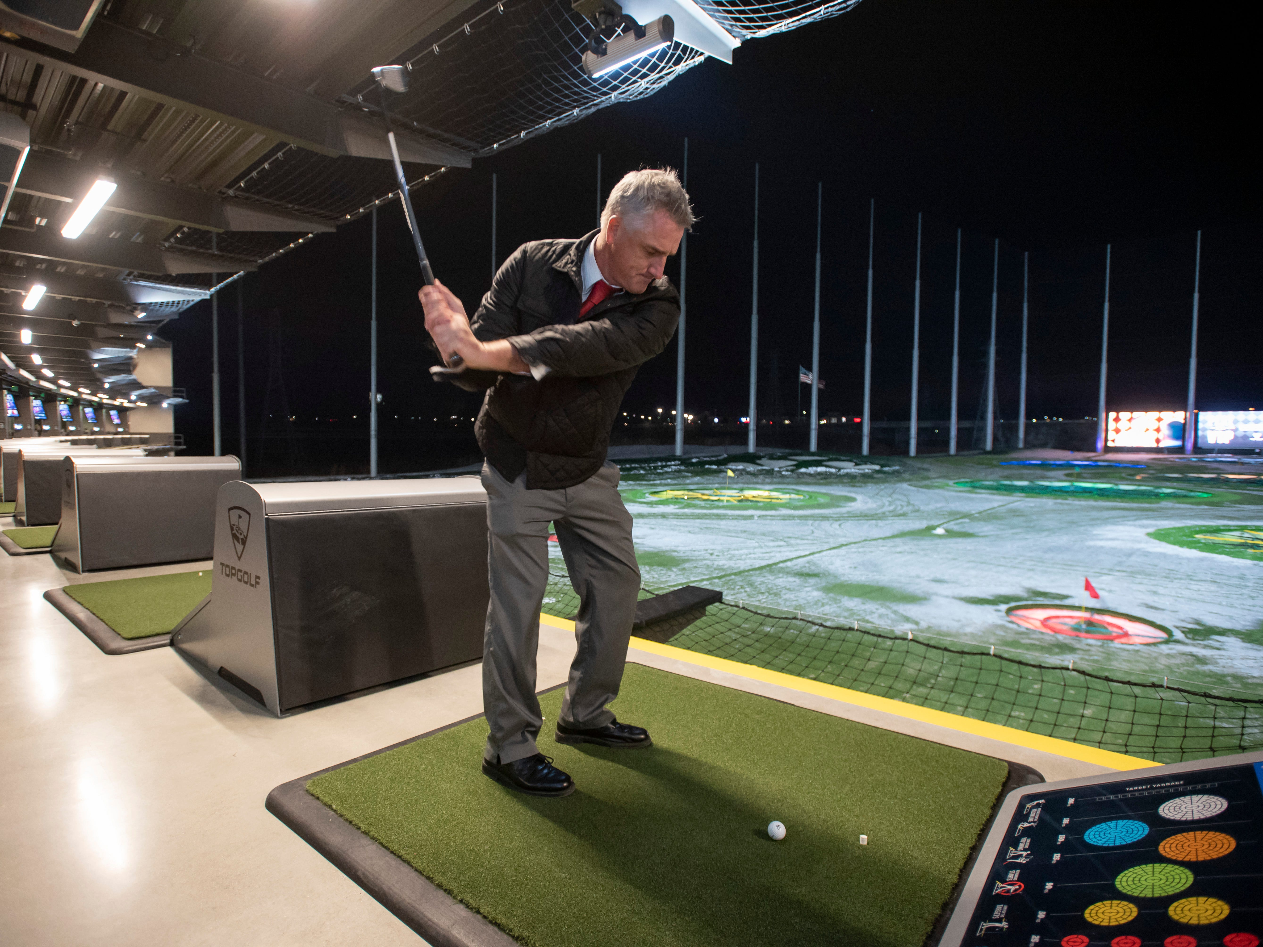 Golf instructor Dave Glasby tries out the driving range during a preview event at Topgolf, in Auburn Hills.