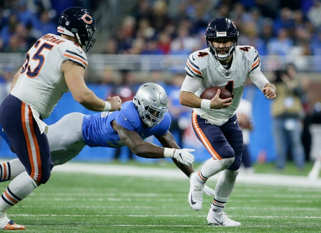 Bears quarterback Chase Daniel, center, completed 27-for-37 for 230 yards with two touchdowns and no interceptions against the Lions.