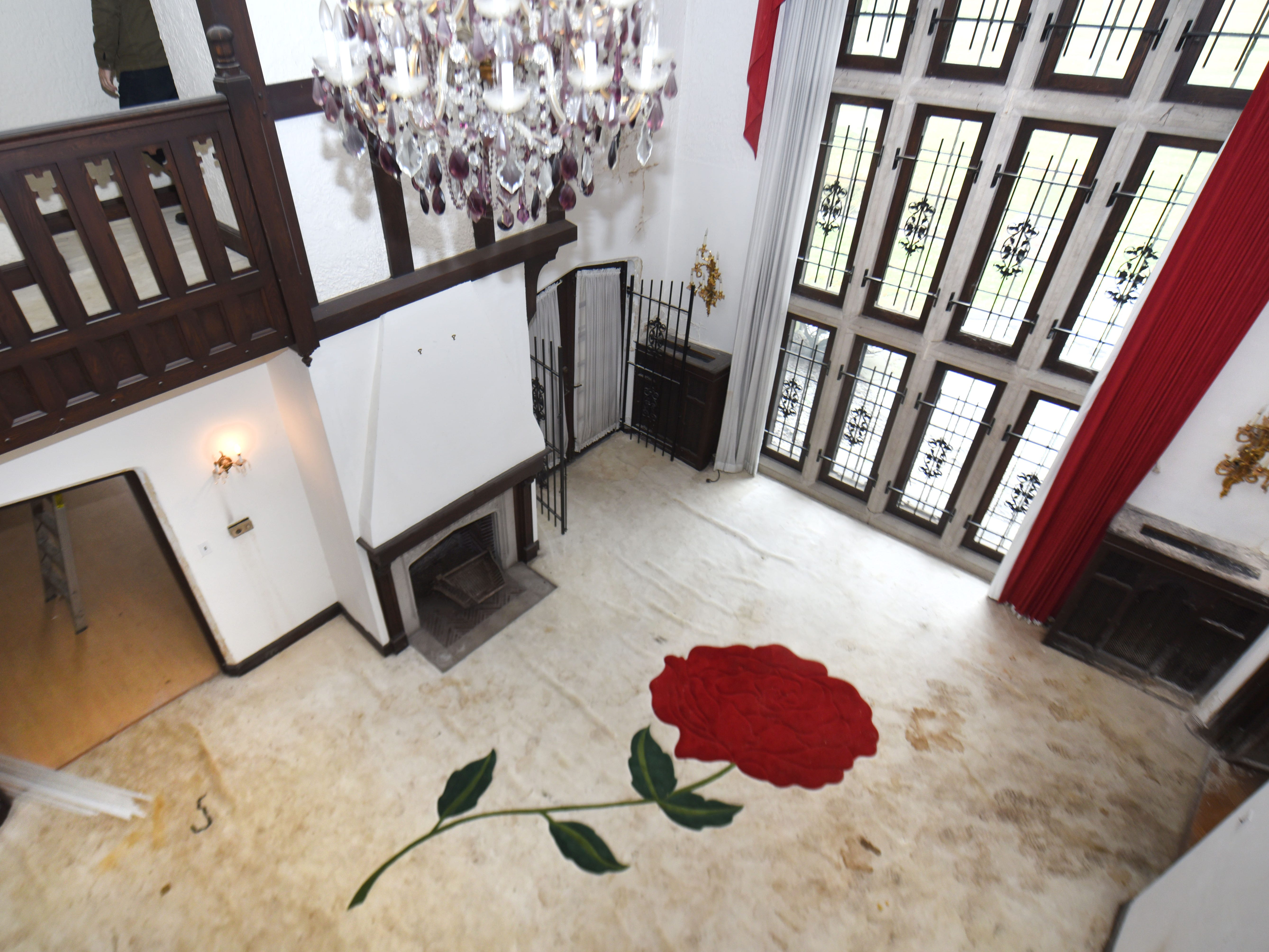 A giant rose is seen in the carpet in the grand living space of the former Detroit home of Aretha Franklin.  Long unoccupied, the 1927 home was opened for a media tour on Thursday.