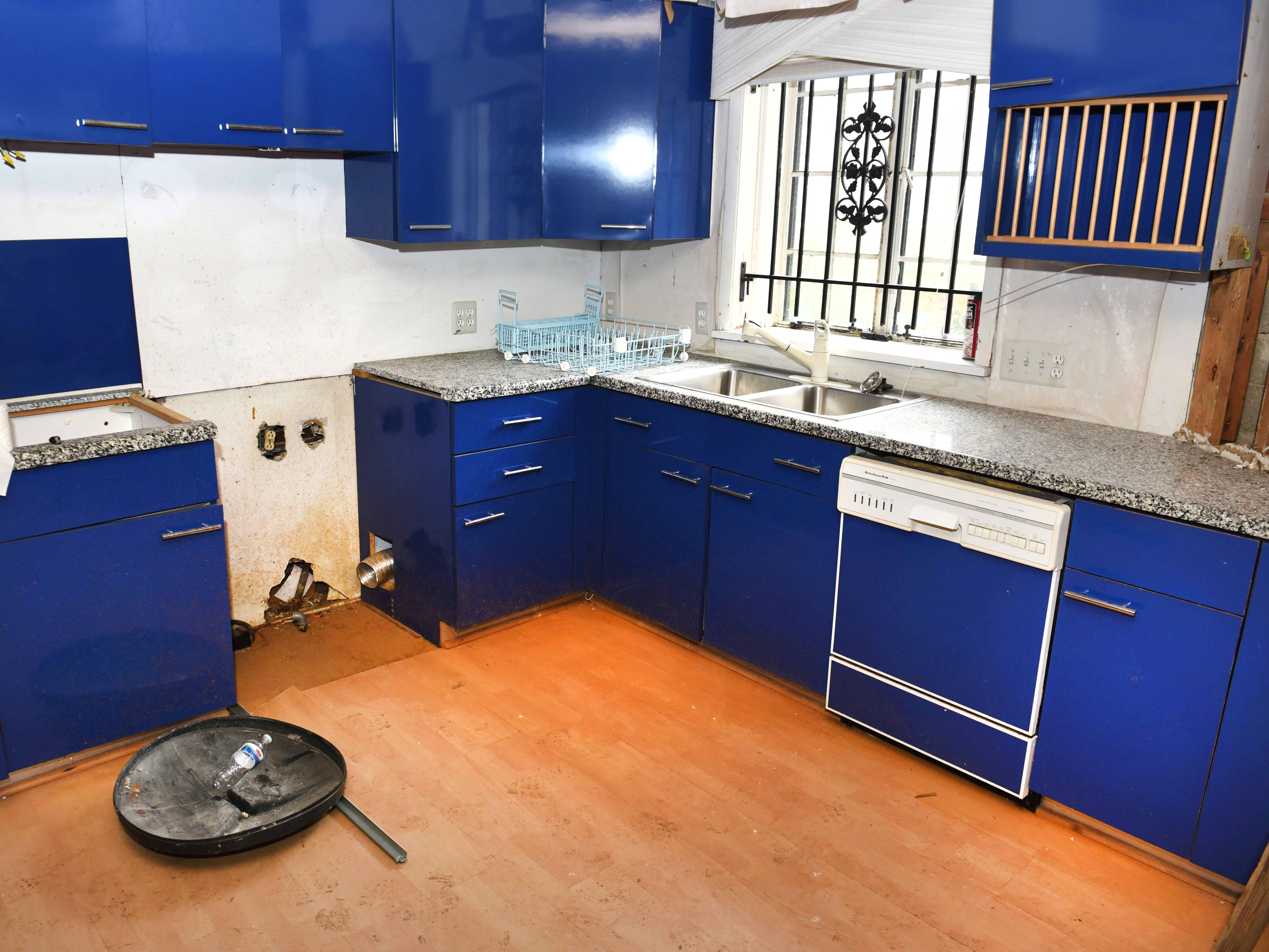 The bright blue cabinets remain in the kitchen of the former home of Aretha Franklin.
