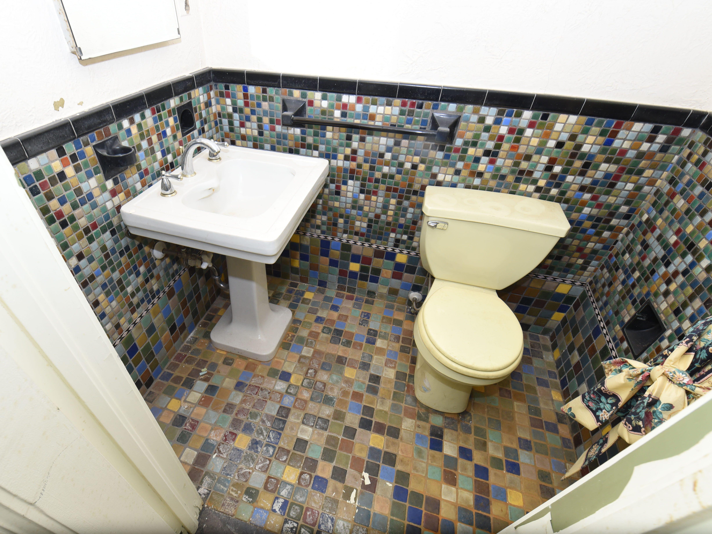 More tile adorns this half-bath.